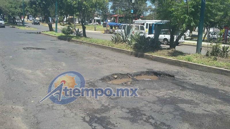 Pese a los esfuerzos de las autoridades, varias calles y avenidas de Morelia parecen campos minados (FOTOS: ALEJANDRA ORTEGA)