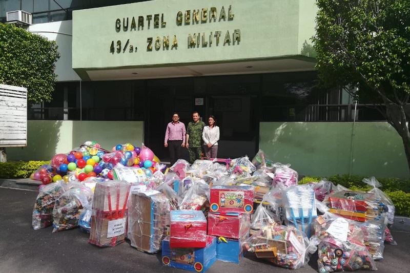 """Este programa consiste en realizar el canje de juguetes """"réplicas de armas"""", por juguetes didácticos y tradicionales, en este caso, en la jurisdicción de la 43 Zona Militar, con sede en el municipio de Apatzingán"""